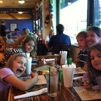 Photo taken at Blue Moon Grill by Leo B. on 4/4/2012