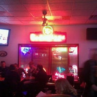 Photo taken at Charlie's Filling Station Lounge by Andrew D. on 2/12/2012