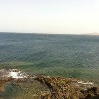 Photo taken at La Puntilla- Playa Melenara by Paloma B. on 3/23/2012