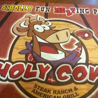 Photo taken at Holy Cow by Ed W. on 3/1/2012