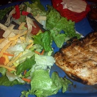 Photo taken at Red Robin Gourmet Burgers by Regina M. on 2/10/2012