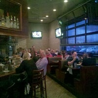 Photo taken at Mudsocks Grill by Andrew A. on 3/23/2012