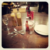 Photo taken at Nando's by Richard H. on 4/20/2012