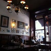 Photo taken at Café Brasilero by Roger B. on 3/9/2012