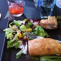 Photo taken at Seatown Seabar & Rotisserie by Mike S. on 8/4/2012