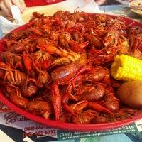 Photo taken at Crazy Cajun Restaurant by Kathleen H. on 5/11/2012