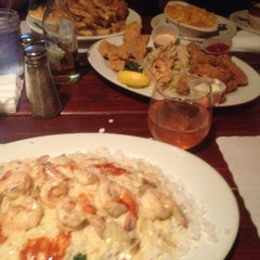 Photo taken at Stevie's Creole Cafe & Bar by Ryan S. on 6/17/2012