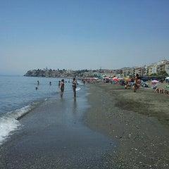 Photo taken at Playa Rincón de la Victoria by Gustavo M. on 7/20/2012