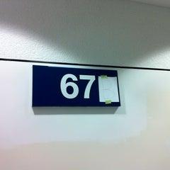 Photo taken at Gate 67B by Christina C. on 3/7/2012