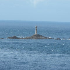 Photo taken at Wolf Rock Lighthouse by Dave on 8/6/2012
