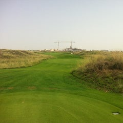 Photo taken at Yas Links Golf Course by Joonas J. on 8/17/2012