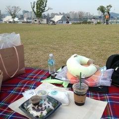 Photo taken at 여의도 한강공원 (Yeouido Hangang Park) by KyungWoo K. on 6/16/2012