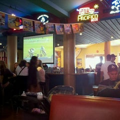 Photo taken at Wipeout Bar & Grill by Cristina B. on 10/9/2011