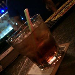Photo taken at The Office Bar & Grill by Benjamin T. on 3/6/2012