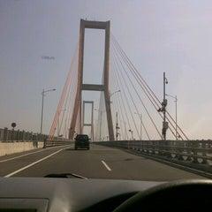Photo taken at Jembatan Suramadu (Suramadu Bridge) by Ika H. on 8/18/2012
