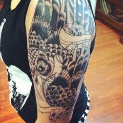 Photo taken at Resurrected Tattoo by Cara K. on 10/22/2011
