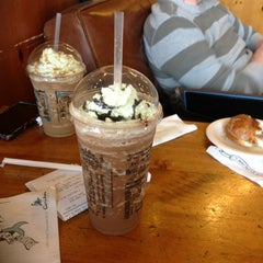 Photo taken at Caribou Coffee by Travis C. on 3/17/2012
