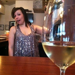 Photo taken at The Tangled Vine Wine Bar & Kitchen by Kim S. on 3/29/2012
