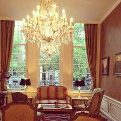 Photo taken at Ambassade Hotel by Elena C. on 7/14/2012