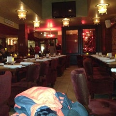 Photo taken at Méchant Boeuf Bar & Brasserie by Scott G. on 12/27/2011