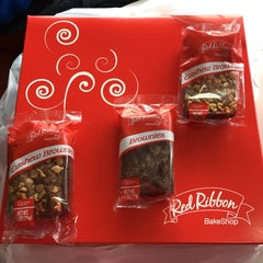 Photo taken at Red Ribbon Bake Shop by Marcia M. on 4/3/2015