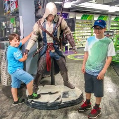Photo taken at EB Games by Brian W. on 7/6/2015