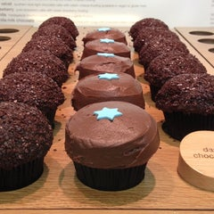 Photo taken at Sprinkles Cupcakes by Maria G. on 12/18/2012