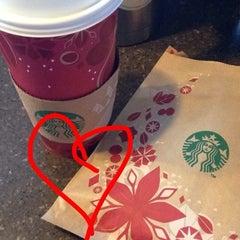 Photo taken at Starbucks by JENNI JANE K. on 12/21/2013
