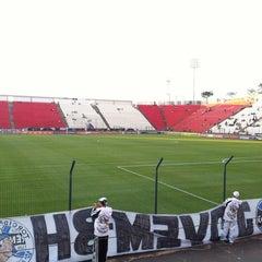 Photo taken at Estádio Joaquim Henrique Nogueira (Arena do Jacaré) - Democrata Futebol Clube by Angelo M. on 6/9/2013