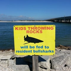 Photo taken at Matanzas Inlet Under The Bridge On The Beach by Justeen K. on 2/15/2013