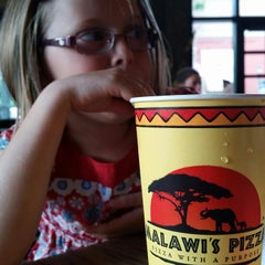 Photo taken at Malawi's Pizza by Jeremy N. on 7/1/2015