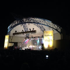 Photo taken at Tire Kingdom Stage @ Sunfest by Chris S. on 5/2/2014