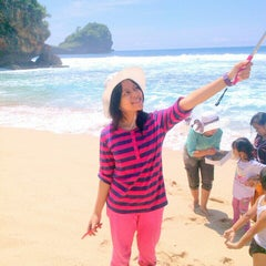 Photo taken at Pantai Sendang Biru by Bening G. on 12/21/2014