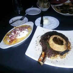 Photo taken at Riverfront Steakhouse by Brandon H. on 2/25/2014