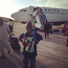Photo taken at Maurice Bishop International Airport by Nasilele P. on 7/21/2013