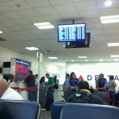 Photo taken at Gate A26 by Christopher G. on 9/15/2012