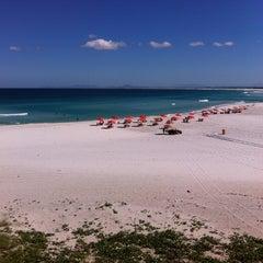 Photo taken at Praia Grande by Marciza B. on 7/5/2013