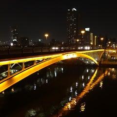 Photo taken at 天神橋 by Kuma on 3/9/2013
