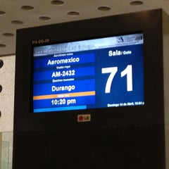 Photo taken at Sala/Gate 71 by Sergio C. on 4/15/2013
