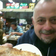 Photo taken at Pizza Zone 'N' Grill by Virgil P. on 9/28/2013