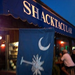 Photo taken at The Folly Beach Crab Shack by E.D. C. on 9/14/2012