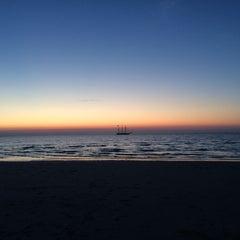 Photo taken at Sea Street Beach by Chris K. on 7/5/2015