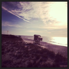 Photo taken at Navarre Beach by Ashlyn S. on 2/20/2013