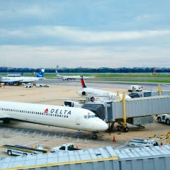 Photo taken at Delta Sky Club by Andrew F. on 6/15/2015