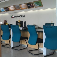 Photo taken at Perodua Sales & Service Centre Glenmarie by Arel B. on 1/12/2013