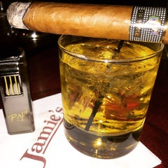 Photo taken at Jamie's Cigar Bar & Restaurant by Fermin P. on 4/8/2015