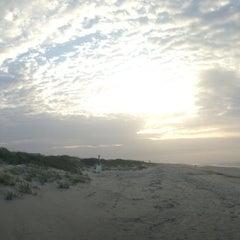 Photo taken at Sunset Beach by Ryan F. on 7/2/2013