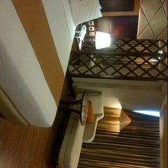 Photo taken at Regent's Park Hotel by dena y. on 5/11/2014