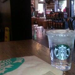 Photo taken at Starbucks by Julia B. on 9/26/2012
