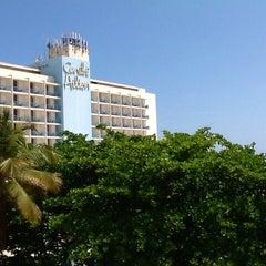 Photo taken at Caribe Hilton Lobby Bar by Jeff S. on 4/27/2014